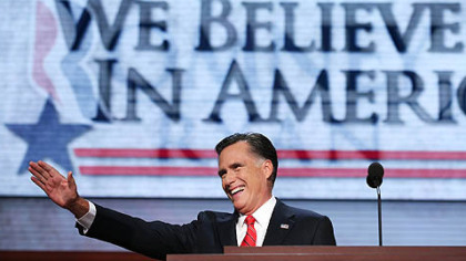 Republican presidential candidate Mitt Romney takes the stage to deliver his nomination acceptance speech during the final day of the Republican National Convention.