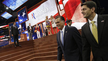 Republican presidential nominee Mitt Romney and vice presidential nominee Paul Ryan walk in for a group picture with their campaign staff at the Republican National Convention in Tampa, Fla.