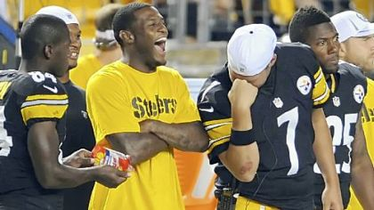 Quarterback Ben Roethlisberger channels a little bit of Tim Tebow on the sideline, much to the delight of Mike Wallace, as the Steelers take on Carolina Thursday night at Heinz Field.