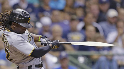 Andrew McCutchen breaks his bat during his RBI single against the Milwaukee Brewers during the eighth inning.