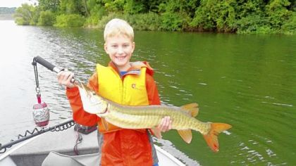 Mitchell Hills and his first musky.