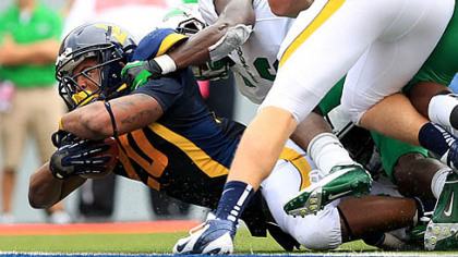 West Virginia running back Shawne Alston dives for one of his two touchdowns in the Mountaineers' win.