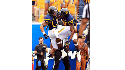 Stedman Bailey, left, celebrates an early touchdown with D.J. Woods.