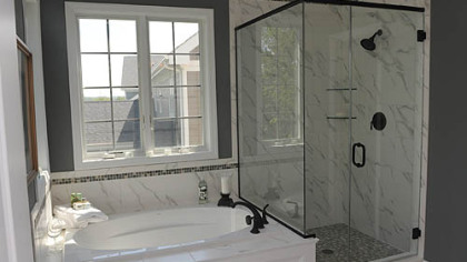 The master bath has a soaking tub, ceramic-tiled shower with heavy glass door and double-bowl sink.