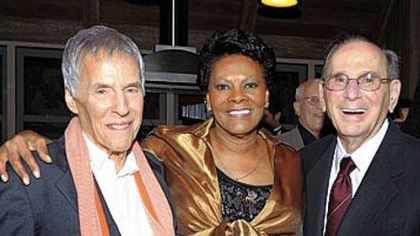 "An Oct. 17, 2011, photo shows songwriters Bert Bacharach, left, and Hal David with singer Dionne Warwick at the ""Love, Sweet Love"" musical tribute to Mr. David on his 90th birthday in Los Angeles. Mr. David died Saturday in Los Angeles."