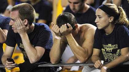 Pitt fans watch as their team falls further behind Youngstown State in the fourth quarter Saturday night at Heinz Field.