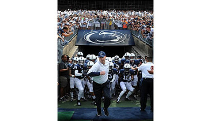 Penn State head coach Bill O'Brien leads the Nittany Lions onto the field at Beaver Stadium for the season opener against Ohio University. Mr. O'Brien replaces coach Joe Paterno, who was fired in the wake of the Jerry Sandusky child sexual abuse scandal.