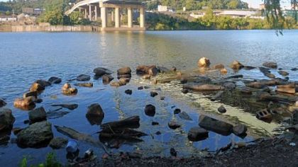 Rocks that are submerged during normal flow form a hull-scraping shoal on the Monongahela River near the Birmingham Bridge. Water is down on lakes, rivers and streams throughout Western Pennsylvania.