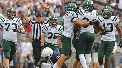 Ohio University players celebrate after linebacker Jelani Woseley intercepted a Penn State pass late in the fourth quarter to seal the win against the hosting Nittany Lions at Beaver Stadium in State College this afternoon.
