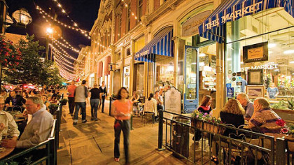 People enjoying an evening in Larimer Square's outdoor cafes and shops.