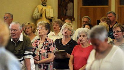 Worhsipers during the vigil Mass for the Feast of the Assumption at St. Elizabeth Ann Seton in Carnegie.