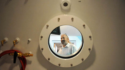 Peter Strobl inside a pressure chamber.