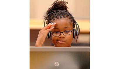 Eighth-grader Tayjanay Reed during orientation for students enrolled in the Pittsburgh Online Academy.