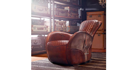 The hand-finished, hand-stitched leather Saddle Chair by Timothy Oulton with actual stirrups on either side. For more information, email Newyork@timothyoulton.com or visit www.timothyoulton.com