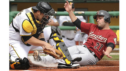 The Astros' Jose Altuve is forced out at home plate by Pirates catcher Rod Barajas Monday at PNC Park.
