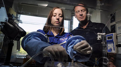 Jennifer Hayden, a biomedical engineering doctoral student at Carnegie Mellon, and neurosurgeon James Burgess work with the Aqueous Immersion Surgical System prototype to be tested under zero gravity through NASA.