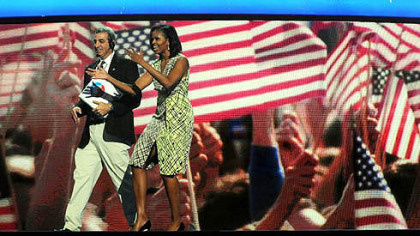 First lady Michelle Obama gets a feel for the stage inside of the Time Warner Cable Arena on Monday before the official start of the Democratic National Convention in Charlotte, N.C.