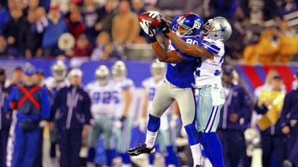 New York big-play receiver Victor Cruz makes a tough catch in front of Dallas defender Orlando Scandrick in the last game of the 2011 regular season -- that game that got the Giants into the playoffs, and they went on to win the Super Bowl.