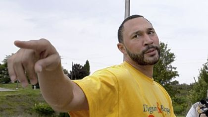Charlie Batch speaks with reporters outside Monessen High School, where he attended a student assembly to speak about the importance of dignity and respect.