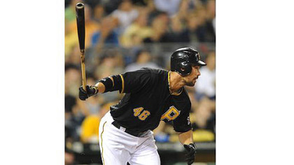 The Pirates' Garrett Jones singles in a run against the Astros.