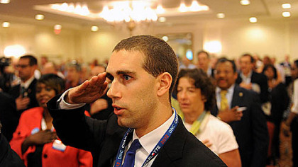 Alan Kennedy-Shaffer, an Army National Guard specialist from Harrisburg, salutes during the Pledge of Allegiance at the final Pennsylvania Delegation breakfast this morning at the Democratic National Convention in Charlotte, N.C.