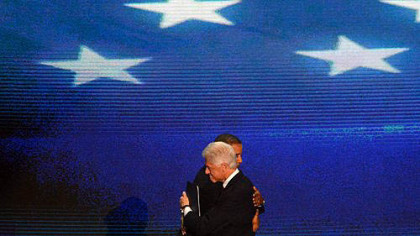 President Barack Obama and former President Bill Clinton embrace after Clinton's speech on day two of the Democratic National Convention in Charlotte, N.C.