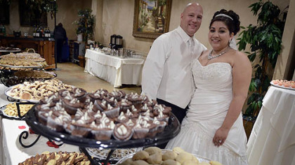 Brian Perris and Cristine Lazzaro at the cookie table celebrating their wedding.