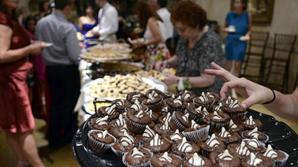 Wedding guests line up to partake at a cookie table celebrating the wedding of Cristine Lazzaro and Brian Perris.