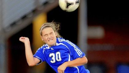 South Park sophomore Victoria Kraemer heads the ball in a soccer match Wednesday at West Mifflin. South Park won, 4-0.