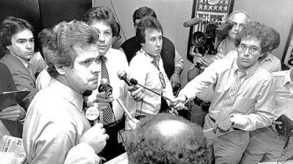 Father Dick Haley, then team director of player personnel, talks to the news media about the team's top draft choice, in 1982, Walter Abercrombie.