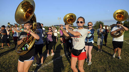 Junior Nora Kupiec, 16, plays the flute Aug. 28 as she practices with the Moon Area High School band at McCormick Elementary School.