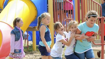 Third-graders play during recess Aug. 29 at Burkett Elementary School in Robinson. Montour School District has closed Ingram Elementary School and placed all third- and fourth-graders at Burkett. Students in K-2 attend Forest Grove Elementary School, also in Robinson.