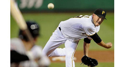 Pirates starter Kevin Correia delivers against the Astros.