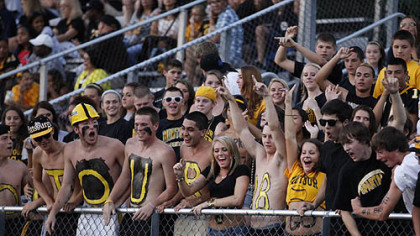 The Montour student cheering section yells for television cameras before the start of its game against Central Valley Thursday at Central Valley.