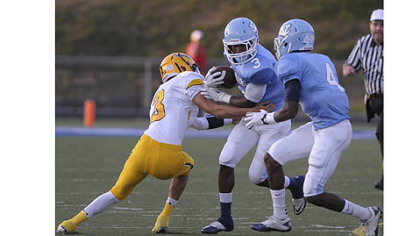 Central Valley&#039;s Jordan Whitehead is tackled by Montour&#039;s Devin Wilson Thursday at Central Valley.
