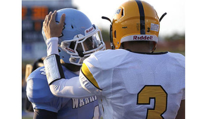 Montour receiver Devin Wilson, right, greets Central Valley receiver Robert Foster before the start of their game Thursday at Central Valley.