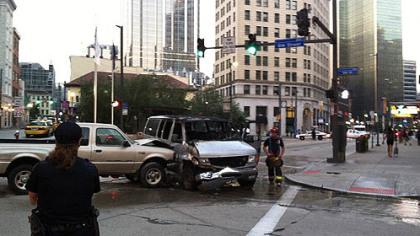 The crash involving a pickup truck and a van shut down a portion of Liberty Avenue at Sixth and Market streets, Downtown.