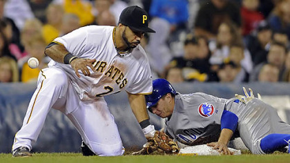 The Cubs&#039; Tony Campana steals third base on the Pirates&#039; Pedro Alvarez in the fifth inning.
