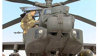 Prince Harry is shown in an Apache helicopter Friday in an image taken from video by a member of his squadron at Camp Bastion in Afghanistan.