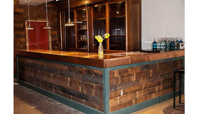 Todd Meyer of Swissvale used salvaged materials in a renovation of E? restaurant in Highland Park. His crew used reclaimed floor boards on the bar front.