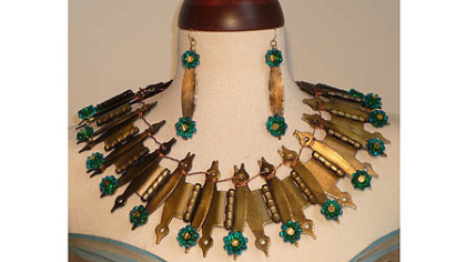 Kathryn Scimone Stanko of Monroeville made a necklace from old cabinet hinges, and beads made by Pittsburgh glass artist Michael Mangiafico.