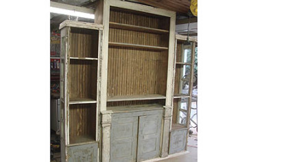 Stephen Palmer of Shelocta used an old cabinet, trim pieces, wainscotting and two old side lights from a front door to make an entertainment center for his mother and father. He painted their names on the piece and the names of their children on the insides of the doors.