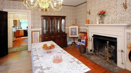 The 18-by-16 dining room sits off of the kitchen and houses a piece of history -- a brass pot that is rumored to have brewed the one of the first batches of Heinz Ketchup -- Sarah Heinz was best friends with Sara Scott (Shaw).
