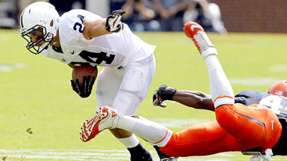 Penn State running back Derek Day (24) breaks a tackle by Virginia's Sammy MacFarlane (44) during the first half of today's game in Charlottesville, Va.