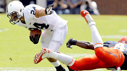 Penn State running back Derek Day  breaks a tackle by Virginia's Sammy MacFarlane in the first half Saturday in Charlottesville, Va.