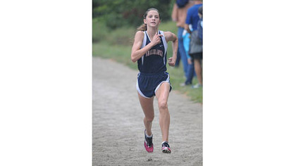 Shaler's Brianna Schwartz took nearly a minute off her personal best time in winning the Red, White & Blue Classic Saturday in Schenley Park.