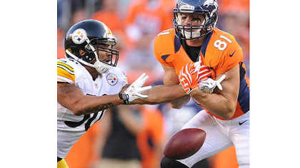 The Steelers' Larry Foote breaks up pass intended for the Broncos' Joel Dreessen.