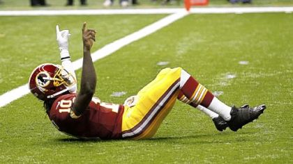 Redskins quarterback Robert Griffin III reacts after throwing a touchdown pass in the first quarter Sunday.