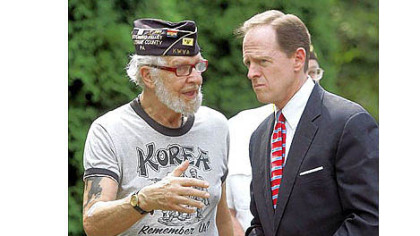 Sen. Pat Toomey, R-Pa., chats with Korean War veteran Robert Alper after speaking Thursday in Wilkes-Barre, in northeastern Pennsylvania. There he discussed a bill he introduced for a one-year pilot program to help veterans find jobs based on military experience. The program would provide new tools for veterans to find jobs online.