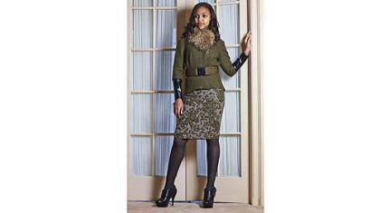 Green wool top with tweed skirt and fur collar, a design for fall by Kiya Tomlin.
